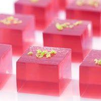 Sophisticated jello shot: Cosmopolitan - Cranberry juice, Orange flavored vodka, Grand Marnier, Roses lime