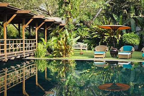 Deckchairs reflecting in the pool, The Governors Residence, luxury hotel…