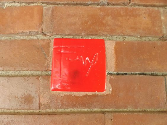 A special wall in Iowa at FLW's Cedar Rock with the signature red tile!