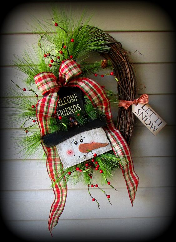 This sweet welcome friends snowman wreath is perfect for ...
