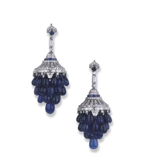A PAIR OF ART DECO SAPPHIRE AND DIAMOND EARRINGS   Each designed as a cascade of sapphire drop-shaped beads suspended from the openwork diamond dome with calibré-cut sapphire band to the diamond line and sapphire collet surmount, circa 1930