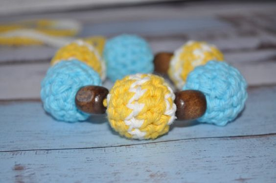 Love the yellow and turquoise!!!  Great baby shower or new mom gift. #crochetbeadnecklace #teeethingnecklace #nursingnecklace #teething #ecofriendlybaby #ecofriendlybabytoy #teethingring #yellowbaby #turquoisebaby