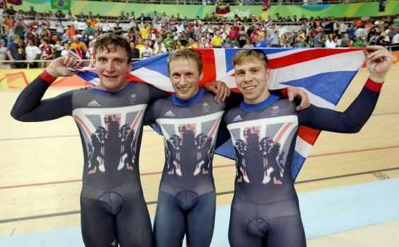 2016 Rio Olympics - Cycling Track - Final - Men's Team Sprint Final Gold Race - Rio Olympic Velodrome - Rio de Janeiro, Brazil - 11/08/2016. Callum Skinner (GBR) of Great Britain, Jason Kenny (GBR) of Great Britain and Philip Hindes (GBR) of Great Britain celebrate after winning the race and setting a new Olympic record.  Many congratulations!!