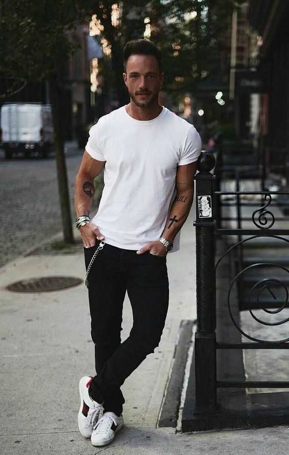 white t-shirt black jeans and trainers