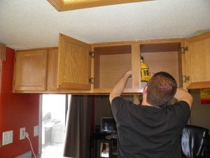taking down cabinets