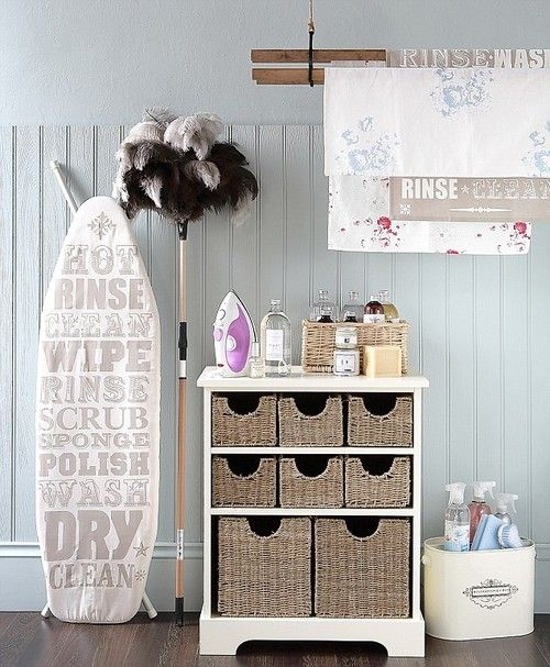Laundry room accessories. Ironing board,  cleaning supply storage, baskets.