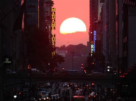The sun sets over 42nd street, perfectly aligned with Manhattan's street grid during Manhattanhenge, on Wednesday, July 11, in New York City.: List Manhattanhenge, Unique Sunset, Street Grid, 42Nd Street, Manhattan S Street, Bucket Lists, Cameras Roll
