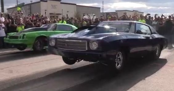 Doc from Street Outlaws pulling a wheel stand on the street