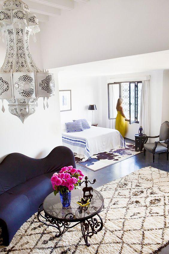 This Coastal Moroccan Home Is the Getaway Of Your Dreams// cowhide rug, Moroccan rug, stripe blanket