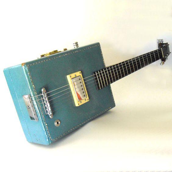 vintage suitcase electric guitar: Vintage Suitcases, Vintage Guitar, Old Suitcases, Suitcase Guitar, Suitcases Lying, Electric Guitar, Guitar Suitcase