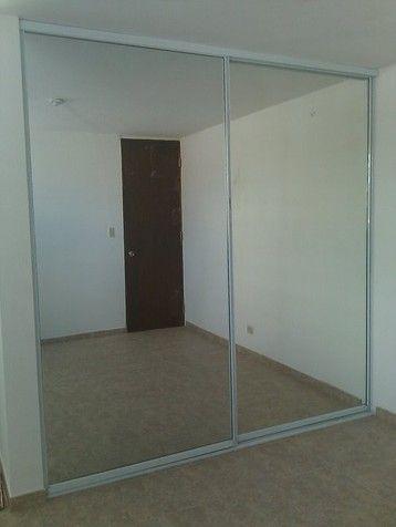 Puerta de closet en espejo corrediza puertas closet for Espejo para puerta