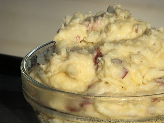 Creamy Red-Skin Mashed Potatoes: 5-pound bag of red potatoes, 1 package cream cheese, 3 cups shredded cheese, 1/4 cup milk, salt & pepper