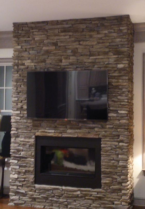We Mounted This Tv On A Stone Wall Above A Decorative Fireplace And Concealed The Cable Box