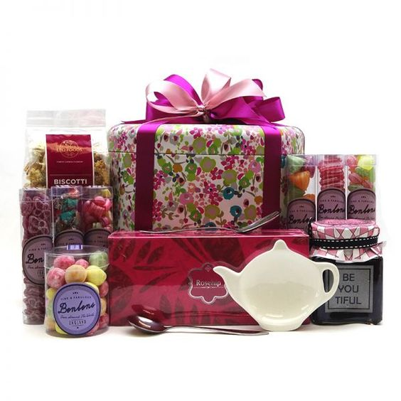 For the lady that loves colour and nice things.... this colourful, floral tin is filled with goodies like assorted Bon Bons from France and England, Rosehip Whole Leaf Organic Tea, Biscotti Leone Chocolate, Raspberry Jam, a 'Sweetie Pie' Jam spoon, a