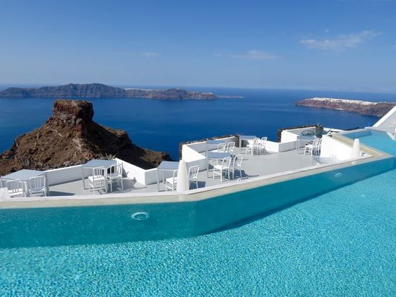 Santorini Grace Hotel- Pool and Restaurant with view of caldera and Therassia in Santorini.