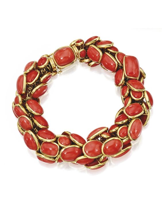 Sotheby's - 18 Karat Gold and Coral Bracelet, Seaman Schepps  Estimate: 15,000 - 20,000 USD  LOT SOLD. 25,000 USD  Set with articulated segments of cabochon coral in various shapes, length 7¾ inches: