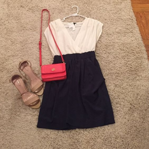 Navy and white dress Cinched waist separates the navy skirt (with pockets!) from the white top. Can be cute with a pinch of color in the accessories :) H&M Dresses