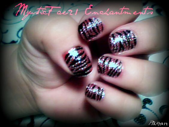"""Here I used the 3d sticker nail design from KIss.  Polish base is OPI """"RED""""  made a good combo I think!"""