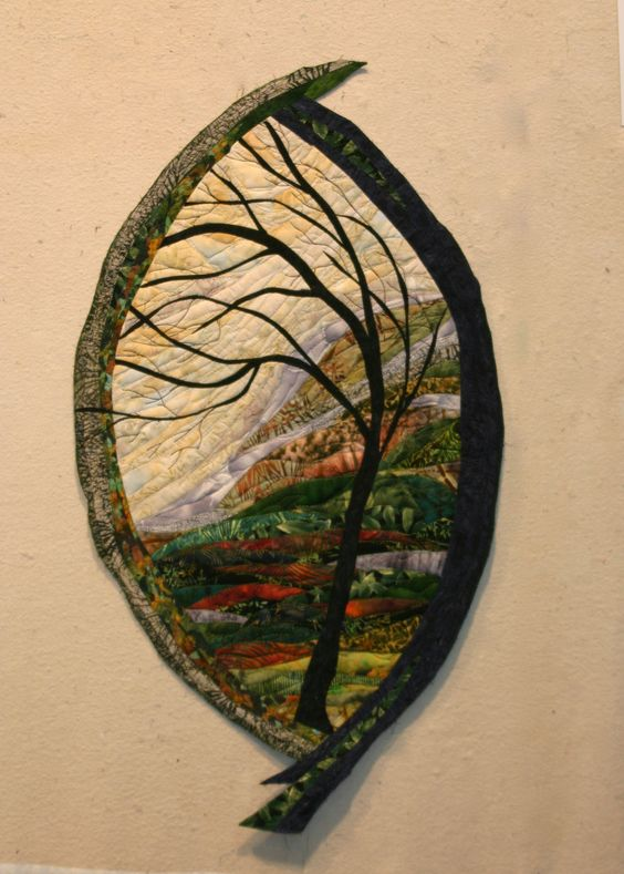 Looking Into Memory, by Murray Johnston. This landscape art quilt is representative of her other works. She is a gifted artist working in the medium of fabric and thread. Go to her website to see more of her amazing quilts. This is one of her free-form quilts.: