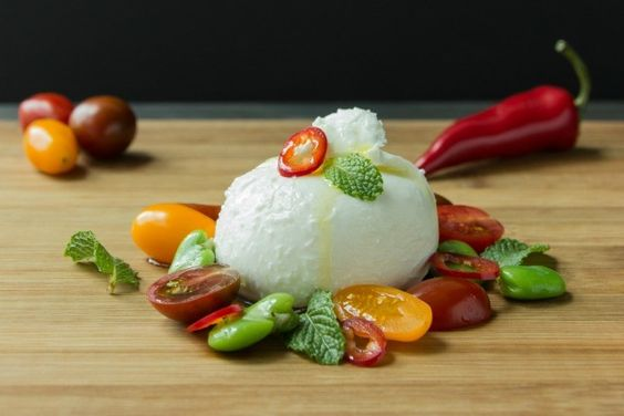 Burrata with fava beans, tomato and mint