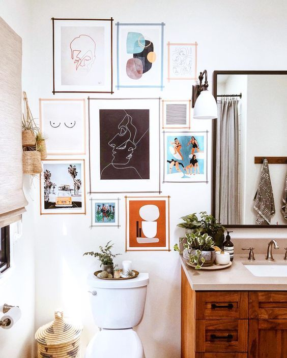 How To Hang A Gallery Wall The Right Way Bathroom Gallery Wall Bathroom Gallery Room Decor