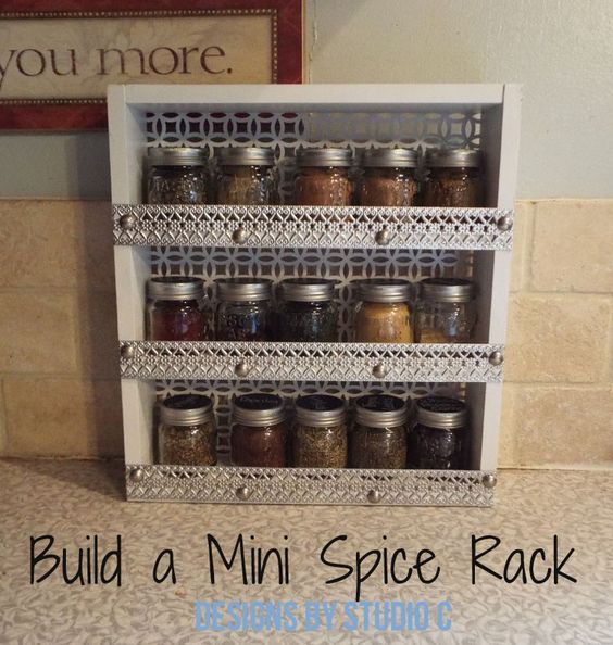 DIY Furniture Plans to Build a Mini Spice Rack.  Uses a wood frame, with decorative metal for the backing and shelf retainers.