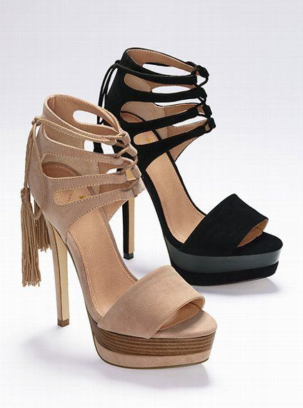 Fringe benefits. Tasseled laces at the ankle of this stiletto sandal create a corseted silhouette