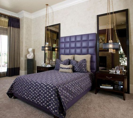 Purple Leather Headboard: The purple tufted headboard and the oversized mirrors make for a grand master bedroom retreat. I love their drama, the striking accent tile gives this bathroom a hint of excitement.