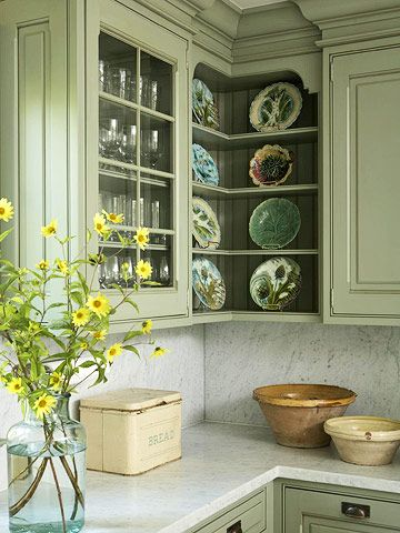 Freshest Vintage: Backed Into a Corner  Corner cubbies show off a beloved display of majolica dishes. Open shelving serves as display for pretty pieces. If you're running short on storage, they can be used for more practical purposes. Pick out a grouping of things worth showing off -- such as cookbooks, dishes, or glassware -- that way your stuff is stored, but still looks like an artful display.