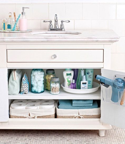 This summer, no matter what storage containers I find at garage sales, I'm buying them!  I need the hair dryer holder too.