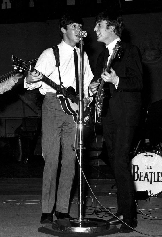 Paul McCartney and John Lennon singing together during a recording session for the BBC Radio programme 'Easy Beat'