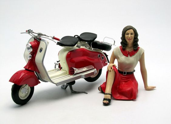 Solido 1:10 Lambretta LD125 Diecast Model Motorcycle - 110005 This Lambretta LD125 With Female Figure (1956) Diecast Model Motorcycle is Red and White and features working side stand, steering, wheels. It is made by Solido and is 1:10 scale (approx. 15cm / 5.9in long). #Solido #ModelMotorbike #Lambretta #MiniModelBikes