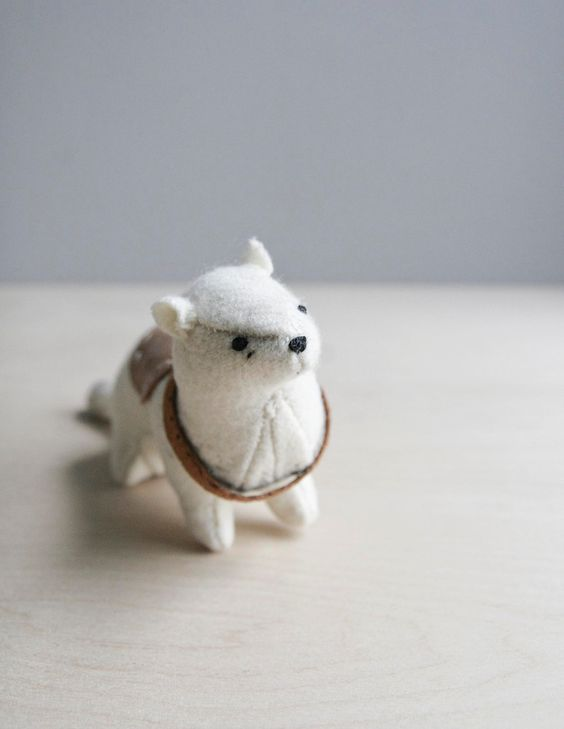 ferret with a saddle / soft sculpture animal. $72.00, via Etsy.