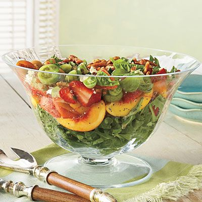 Strawberry Fields Salad    Ripe orange nectarines add a colorful layer of flavor to this refreshing salad. Layers of greens, strawberries, feta cheese, green tomato, fresh basil, and glazed pecans make for an unbeatable summer salad.