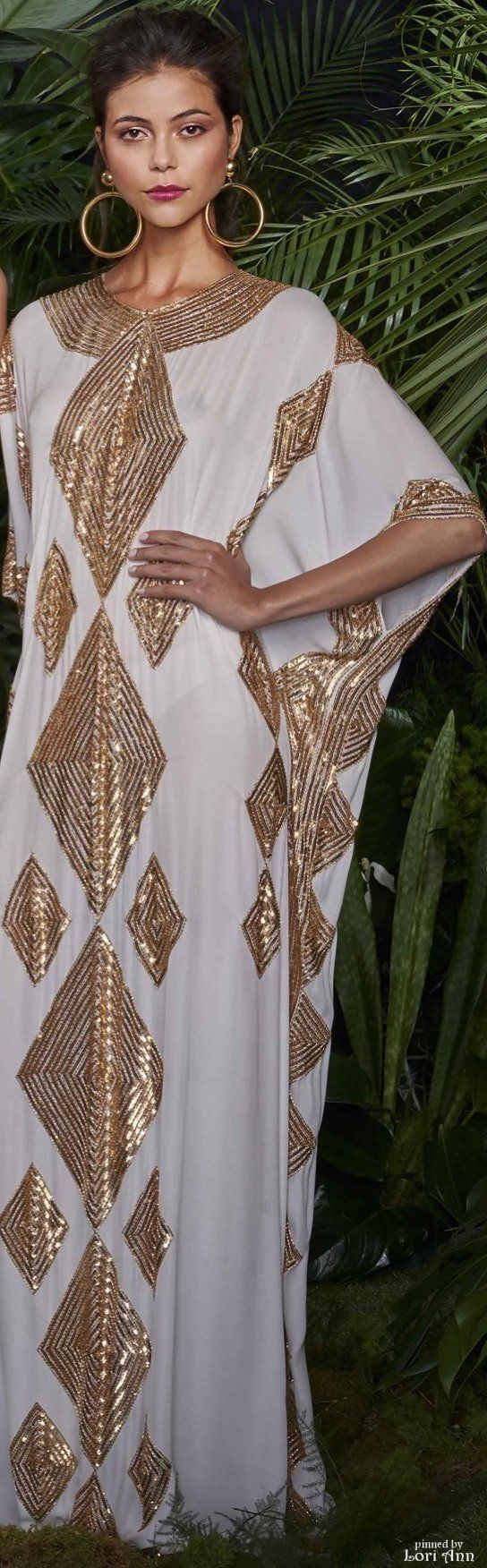 This is so Egyptian and Aztec themed. I could really see someone like Jennifer Lopez or Sofia Vergara looking absolutely stunning in this gorgeous gown.