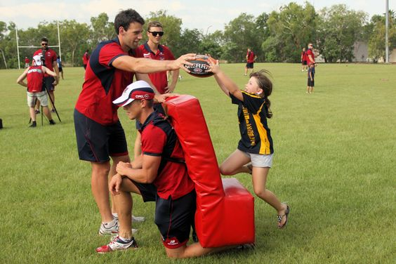The Melbourne Demons hold a footie clinic for locals in Jabiru