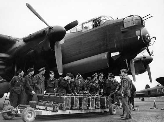 Allied Strategic Air Offensive: The 'round the clock' bombing by the RAF and USAAF necessitated closer liaison between the two bomber forces, and even at squadron level goodwill visits between neighboring units helped foster the spirit of co-operation. Here a B-17 Flying Fortress crew of the 96th Bomb Group, US Eighth Air Force, mingle with Lancaster crews of No 622 Squadron at Mildenhall in the spring of 1944.