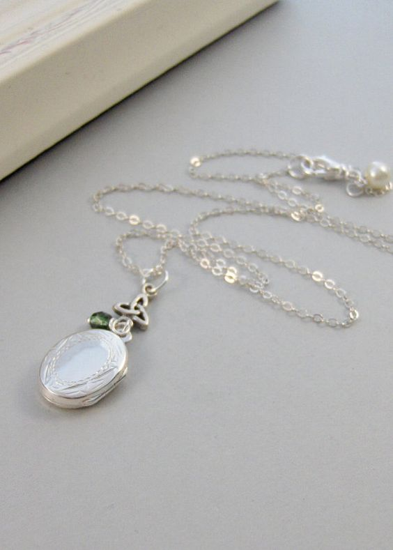 Hey, I found this really awesome Etsy listing at http://www.etsy.com/listing/113571039/sterling-knotlocketsilver-locketsterling