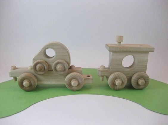 on Etsy from greenbeantoys. Love the car transporter.