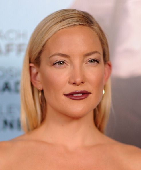Kate Hudson with sleek hair, dark lips and barely there eye makeup on July 14.