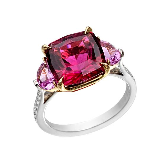 Paolo Costagli Pink Tourmaline & Pink Sapphire Ring Cushion-cut pink tourmaline ring in platinum with half moon-shaped pink sapphire side stones and an 18k yellow gold basket, the shanks partway set with round-cut diamonds. Pink tourmaline weighing 5.17 carats, two pink sapphires weighing 0.99 total carats and diamonds weighing 0.20 total carats.