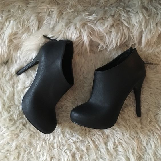 Black Platform Bootie Black platform booties with a chic stiletto heel by Michael Antonio. Only worn twice; excellent condition. These go with everything! Michael Antonio Shoes Ankle Boots & Booties
