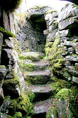 Caisteal Grugaig Broch, in semi ruinous condition, but benefitting from not having been restored and manicured. It stands on a hill called Faire an Duine (The Watchplace of the Tower) and commands views across the narrows joining Loch Alsh and Loch Duich, and up Loch Long. It's most notable feature is a massive triangular lintel. Caistel Grugaig is held to be the home of the witch Grugaig, who was the mother of the giants Telve and Todder who built the Glenelg brochs a few miles to the…
