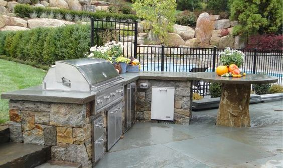 Amazing Outdoor Patios and Kitchens with Laying Flagstone on Concrete Slab also Hanstone Quartz Countertops