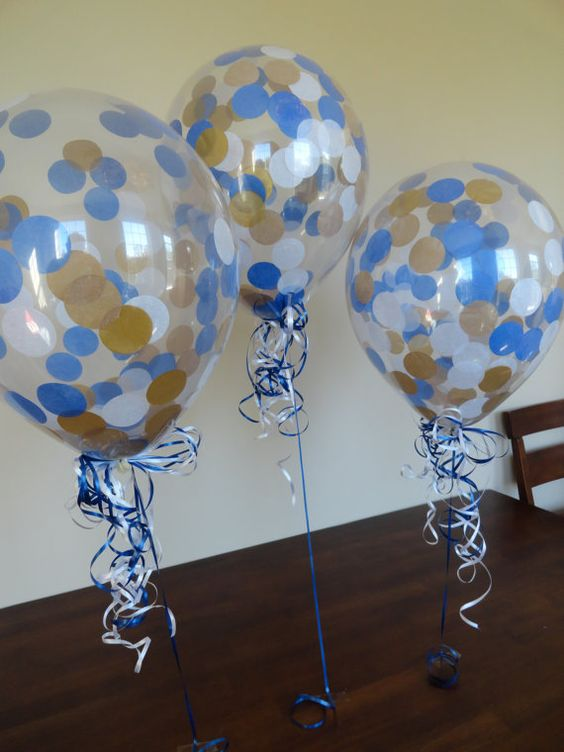 """Details: - Includes 16 Clear Qualatex latex balloons pre-filled with Royal Blue, Gold, & White tissue paper confetti -16"""" balloons are 3 times"""