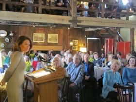 Michele Bachmann addresses crowd at Eagle Forum luncheon in Ladue. Group founder Phyllis Schlafly is seated at right. Credit Jo Mannies/St. Louis Public Radio