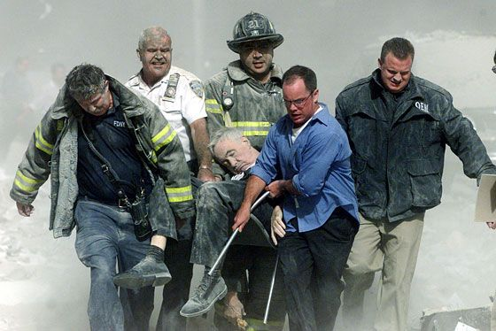 Rescuers carry Father Mychal Judge's body from Tower One. He was the first and most famous victim of the World Trade Center attack.  Reuters