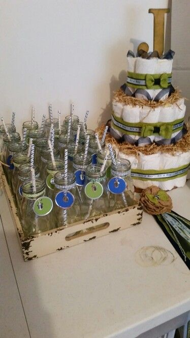Blue/Green Baby Shower diaper cake, mommy to-be ribbon, and drinking glasses.