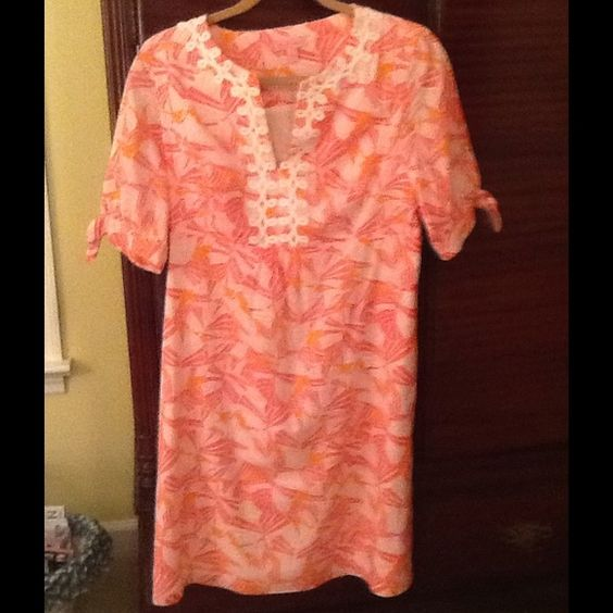 Lilly Pulitzer Dress Orange and pink print Lilly Pulitzer dress V neck with lace details.  Knee length. Lilly Pulitzer Dresses
