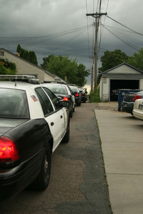 Police action at a foreclosed home occupied by protesters in Minneapolis. Photo by Eric Blom.